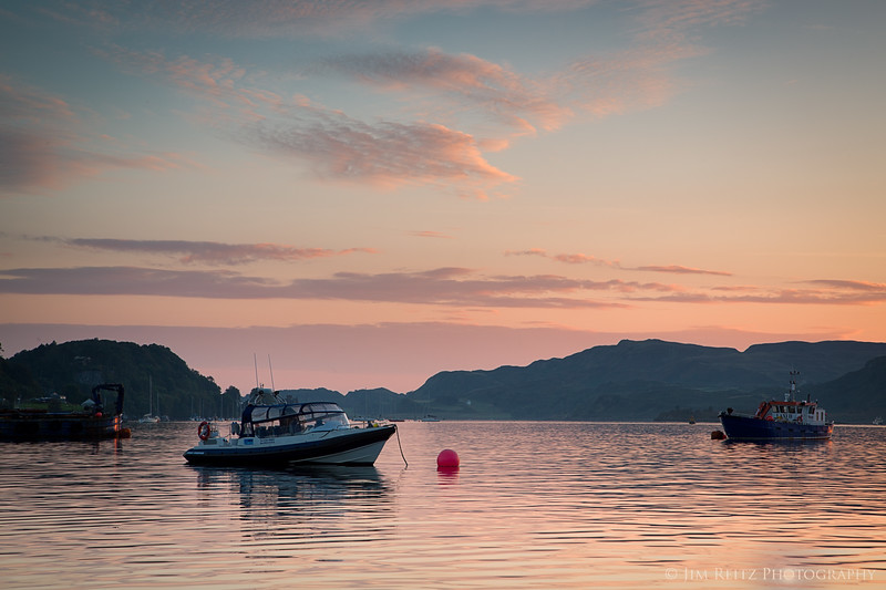 Sunset over the harbor at Oban, Scotland.