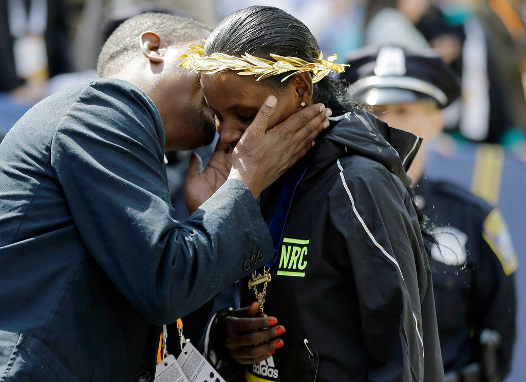 . Atsede Baysa, of Ethiopia, is congratulated after winning the women\'s division of the 120th Boston Marathon on Monday, April 18, 2016, in Boston. (AP Photo/Elise Amendola)