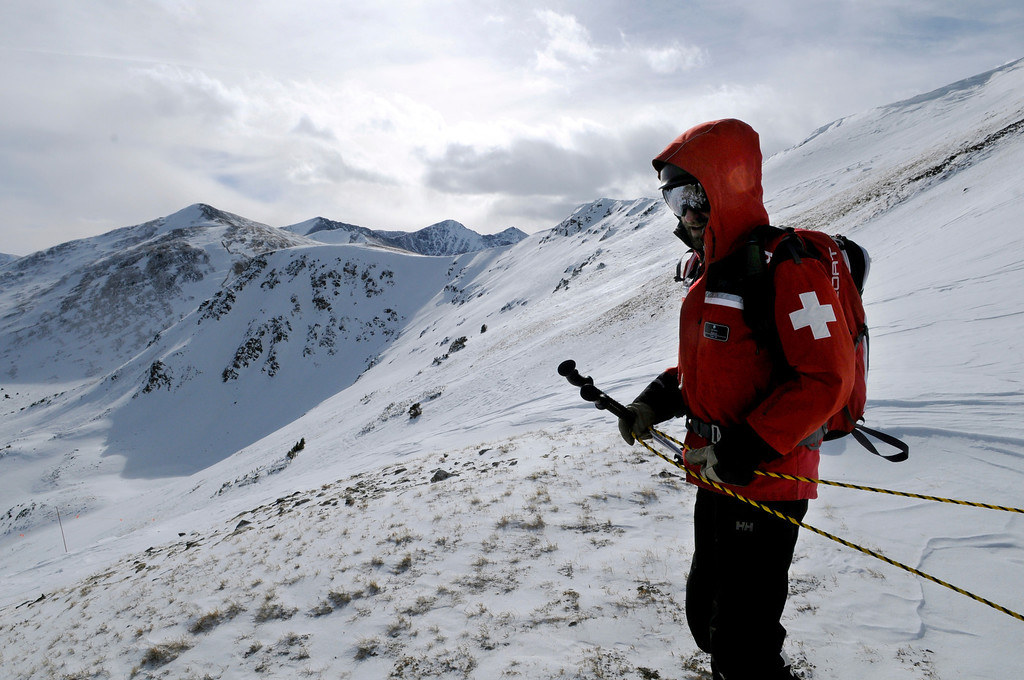 ". A Breckenridge Ski Patrol member sets ropes to mark a boundary on the new Peak 6 expansion scheduled to open at noon on Wednesday. Looking south toward Peak 7 on the left, the new terrain includes ""Serenity Bowl\"" and the extreme terrain of \""The Six Senses.\"" Scott Willoughby, The Denver Post"