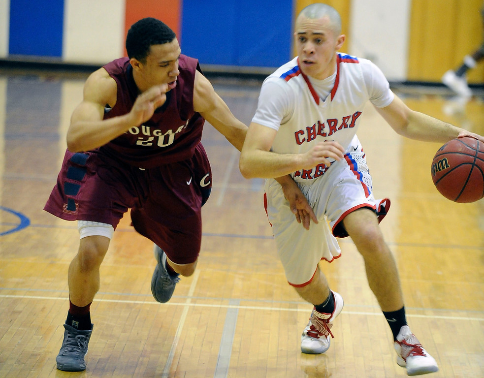 . GREENWOOD VILLAGE, CO. - FEBRUARY 6: Sam Stoveall of Cherry Creek tries to drive past Cherokee Trail\'s Izaiah Lottie in the second half Wednesday night at Cherry Creek High School. (Photo by Steve Nehf, The Denver Post)