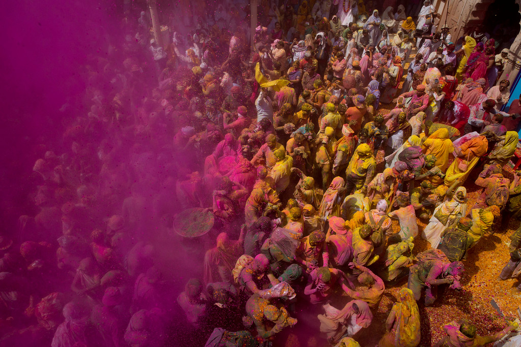 . Locals including Hindu widows throw flower petals and colored powder during the religious arrival of spring festival called Holi at the Gopinath temple in Vrindavan, 180 kilometers (112 miles) south-east of New Delhi, India, Thursday, March 9, 2017. Up to just a few years ago the festival was forbidden for Hindu widows. Like hundreds of thousands of observant Hindu women, they would have been expected to live out their days in quiet worship, dressed only in white, with their very presence being considered inauspicious for all religious festivities. (AP Photo /Manish Swarup)