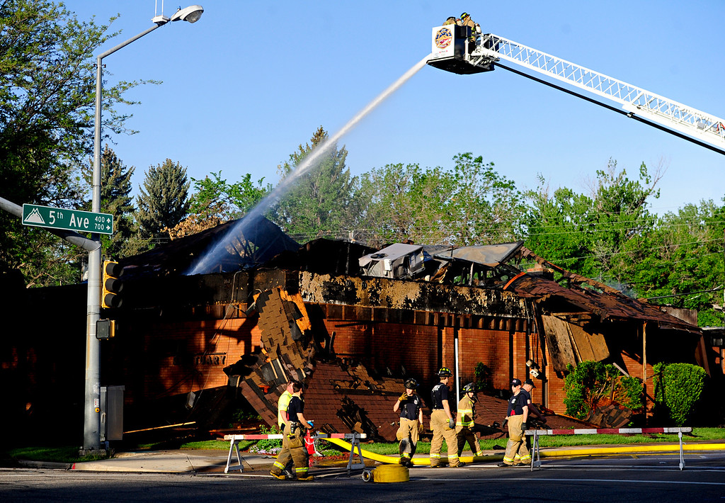 . Howe Mortuary continues to smolder Tuesday morning, May 28, 2013,  in Longmont, Colo., after an overnight fire that caused the roof to collapse.  The cause of the fire is under investigation.  (AP Photo/The Daily Times Call, )   (Greg Lindstrom/AP Photo/Times-Call)