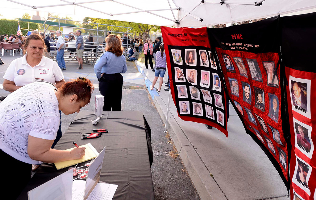 . People visit a variety of victims booths during the annual Victims Candlelight Vigil at the police station in San Bernardino April 23, 2013.  GABRIEL LUIS ACOSTA/STAFF PHOTOGRAPHER.