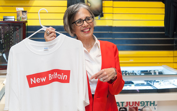 08/02/18 Wesley Bunnell | Staff Ruby Corby O'Neill holds up a New Britain t-shirt at The Hive during a stop on her tour of downtown New Britain. O'Neill is running for for Congress for Connecticut's 5th district.