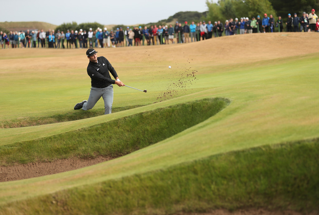 . Jon Rahm of Spain plays out of a bunker on the 6th hole during the second round of the British Open Golf Championship in Carnoustie, Scotland, Friday July 20, 2018. (AP Photo/Peter Morrison)
