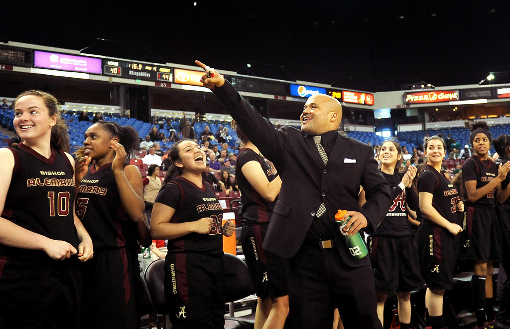 . Alemany High School girl\'s basketball coach Bryan Camacho points to the fans during the final seconds against Sacred Heart Cathedral during the Div III 2013 CIF State Basketball Championship game at the Sleep Train Arena, in Sacramento, Ca March 22, 2013.  Alemany won the game 46-40.(Andy Holzman/Los Angeles Daily News)