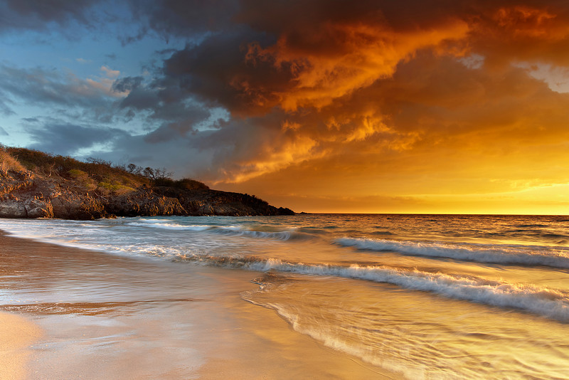 Hapuna Beach has been voted the #1 beach in the US more than once because the sand and water are just so perfect.  Sometimes the volcanic fog, called 'vog' creates surreal sunsets like this!