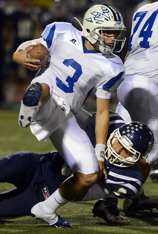 . Alta Loma\'s Jacob Hennie is pulled down by Los Osos\'s Allan Rios at Los Osos High School in Rancho Cucamonga Friday, October 11, 2013. (Staff photo by Jennifer Cappuccio Maher)