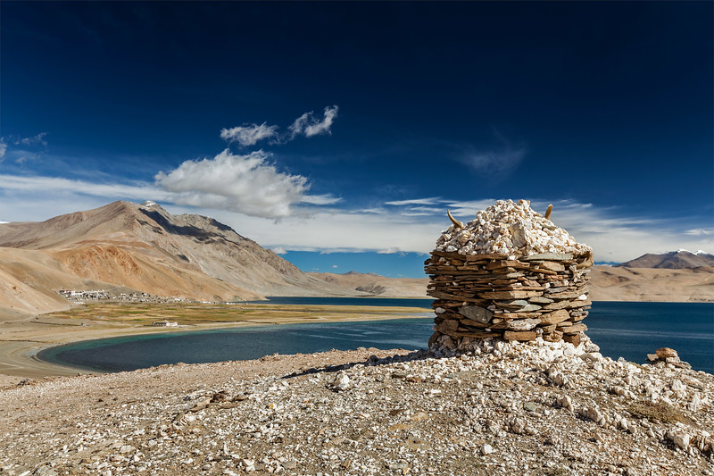 Stone cairn at Himalayan lake Tso Moriri, Korzok,  Ladakh, Jammu and Kashmir, India