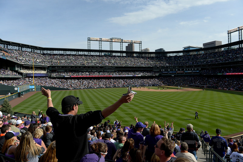 . DENVER, CO. - APRIL 04: Fans ready for the seventh inning during the Colorado Rockies home opener against the Arizona Diamondbacks at Coors Field in Denver, CO April 04, 2014. (Photo By Craig F. Walker / The Denver Post)