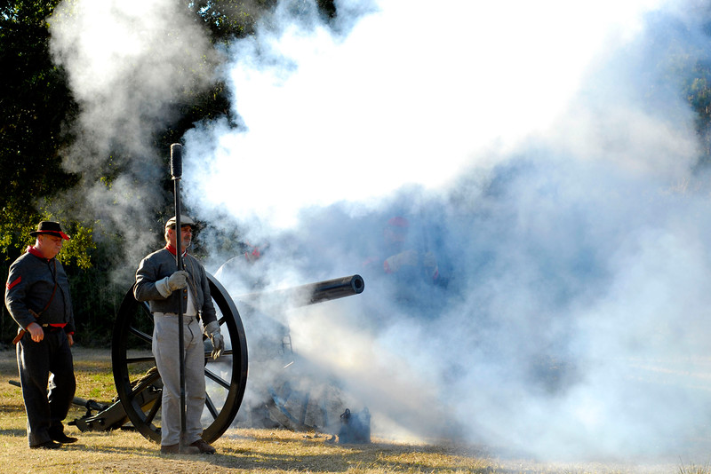 Smoke covers the area after reenactors with the 13th Battalion, North Carolina Light Infantry, D-Company perform a demonstration firing of a 10-pound Parrot canon at the 146th Anniversary of the Fall of Ft. Anderson in Brunswick Town, North Carolina on Sunday, February 20, 2011. Photo Copyright 2011 Jason Barnette