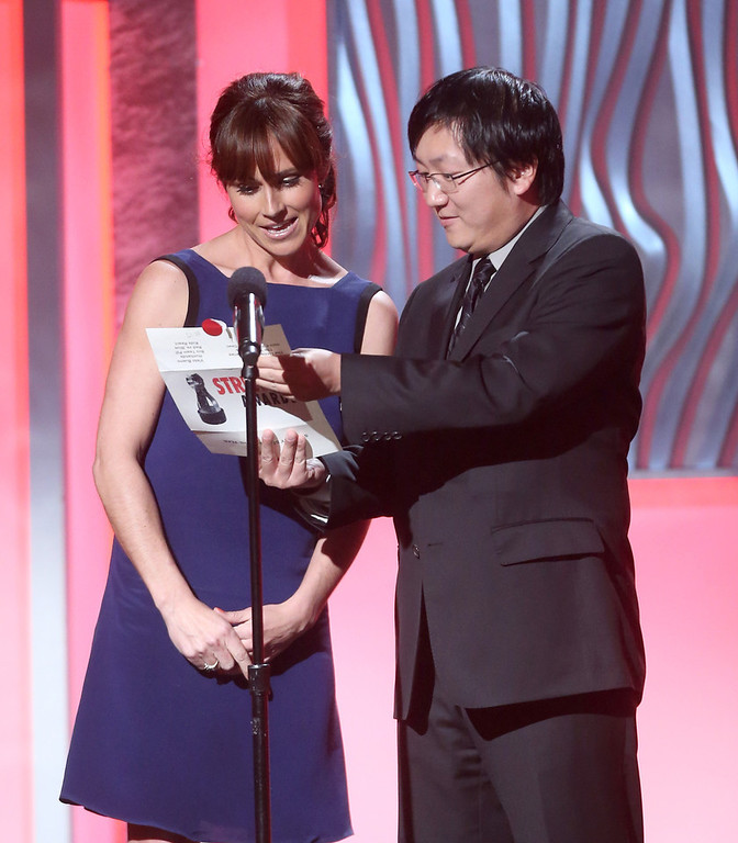 . Presenters Nikki DeLoach and Masi Oka speak onstage at the 3rd Annual Streamy Awards at Hollywood Palladium on February 17, 2013 in Hollywood, California.  (Photo by Frederick M. Brown/Getty Images)