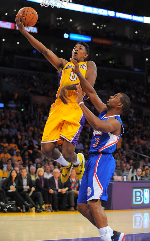 . Lakers Nick Young goes for a layup against Chris Paul in the NBA season opener between the Lakers and Clippers at Staples Center in Los Angeles, CA on Tuesday, October 29, 2013.   (Photo by Scott Varley, Daily Breeze)