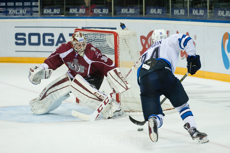 Goalkeeper of Dinamo Riga Joacim Eriksson (30) saves the goal of Pavel Poryadin (24)
