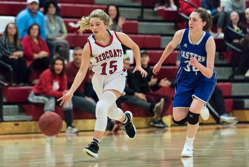 12/17/18  Wesley Bunnell | Staff  Berlin basketball vs Bristol Eastern at Berlin High School on Monday evening. Carly Grega (15) on the fast break pursued by Maura McGuire (30).