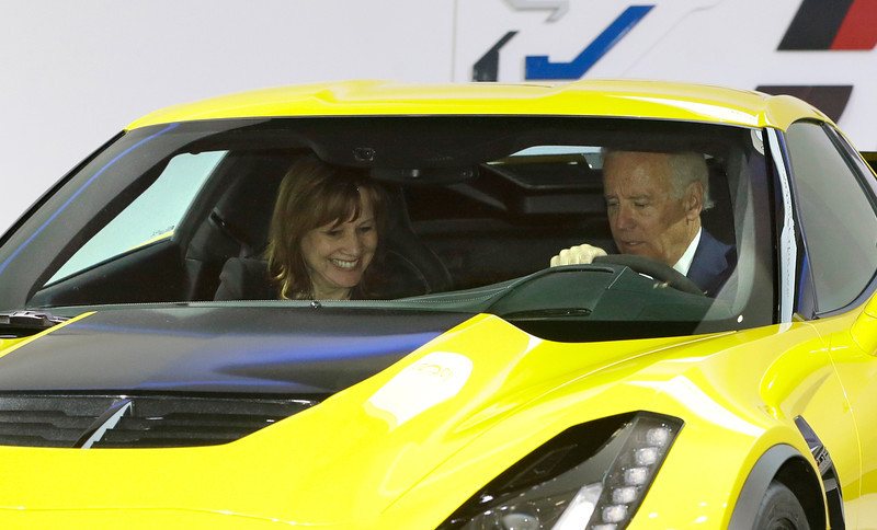 . Vice President Joe Biden and General Motors CEO Mary Barra sit in a Corvette Stingray during a tour of the North American International Auto in Detroit, Thursday, Jan. 16, 2014. Biden said the U.S. auto industry\'s resurgence since the 2009 federal bailout provides a strong basis for a Motor City recovery.  (AP Photo/Carlos Osorio)