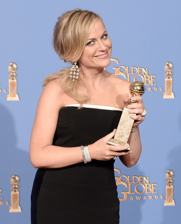 . Actress Amy Poehler, winner of Best Actress in a Television Series - Musical or Comedy for \'Parks and Recreation,\' poses in the press room during the 71st Annual Golden Globe Awards held at The Beverly Hilton Hotel on January 12, 2014 in Beverly Hills, California.  (Photo by Kevin Winter/Getty Images)