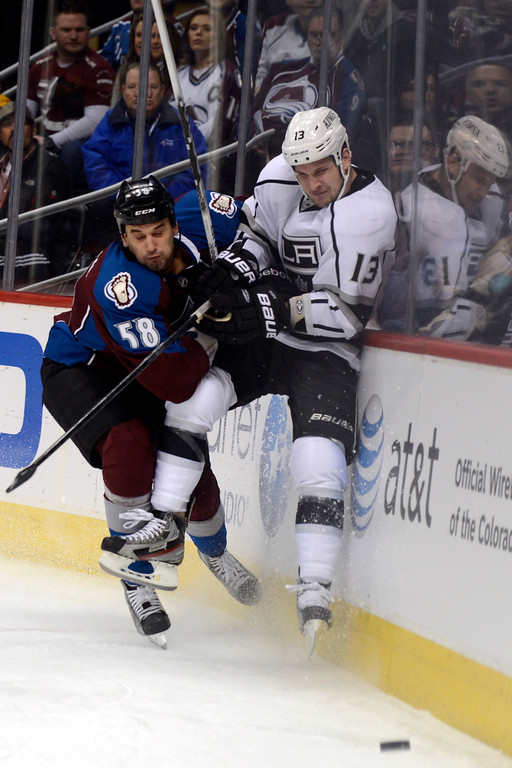 . DENVER, CO. - JANUARY 22: Colorado Avalanche left wing Patrick Bordeleau (58) checks Los Angeles Kings left wing Kyle Clifford (13) during the first period. The Colorado Avalanche hosted the Los Angeles Kings at the Pepsi Center on January, 22, 2013.    (Photo By John Leyba / The Denver Post)