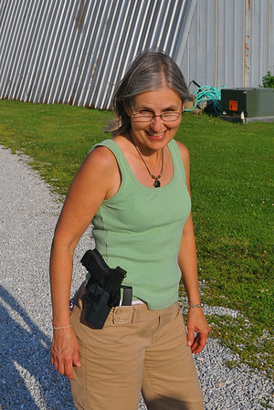 Susie shooting a Glock