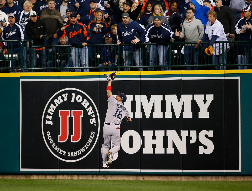. Boston Red Sox right fielder Shane Victorino makes a catch on a Detroit Tigers\' Miguel Cabrera fly ball in the seventh inning during Game 4 of the American League baseball championship series Wednesday, Oct. 16, 2013, in Detroit. (AP Photo/Paul Sancya)
