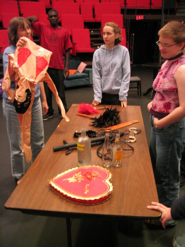 Discussing the sex toys table at It's Not All About Sex rehearsal.