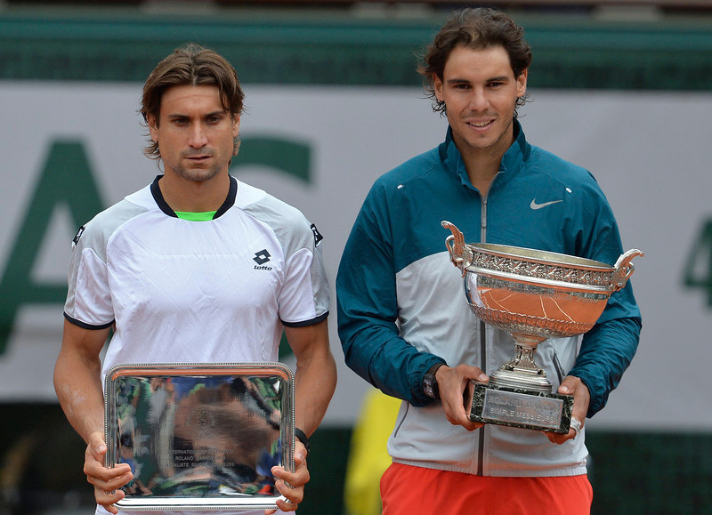 . Spain\'s Rafael Nadal (R) and Spain\'s David Ferrer pose with their trophies after their 2013 French tennis Open final at the Roland Garros stadium in Paris on June 9, 2013. Nadal won the tournament.   MIGUEL MEDINA/AFP/Getty Images