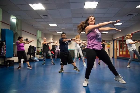01/03/19 Wesley Bunnell | StaffrrZumba instructor Angel Cyr, front, leads the class at the YMCA on Friday evening January 3, 2019 through their paces.