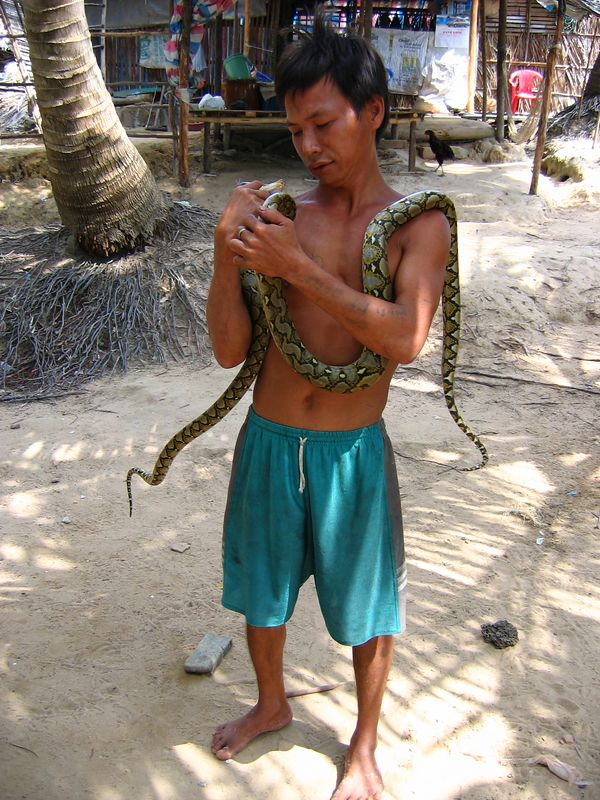 village guy with a snake #2