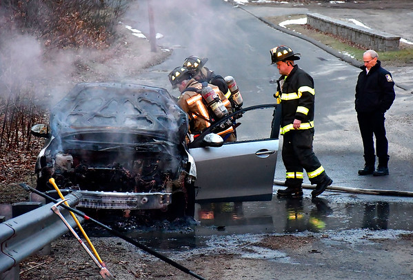 1/30/2020 Mike Orazzi | Staff Bristol firefighters extinguish a car fire on Ambler Road near Birge Pond late Thursday afternoon. No one was injured and the fire was put out quickly.