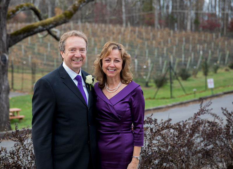Bride and Groom with arbor in background.jpg
