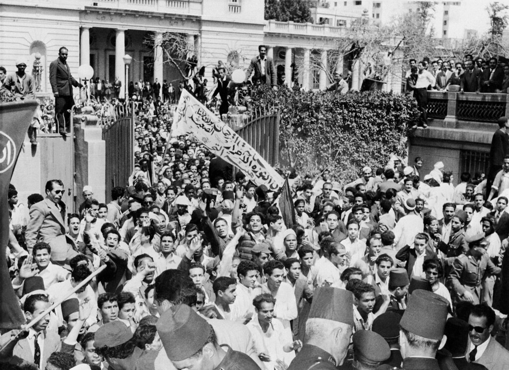 . A large crowd storms into the Ministry Council Headquarters 28 March 1954 in Cairo, during a demonstration supporting the revolutionary regime.        AFP/Getty Images