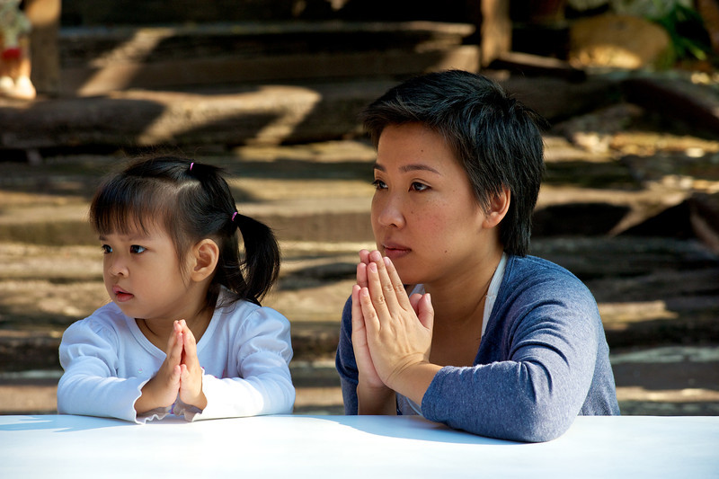 PF and mum listening to prayers