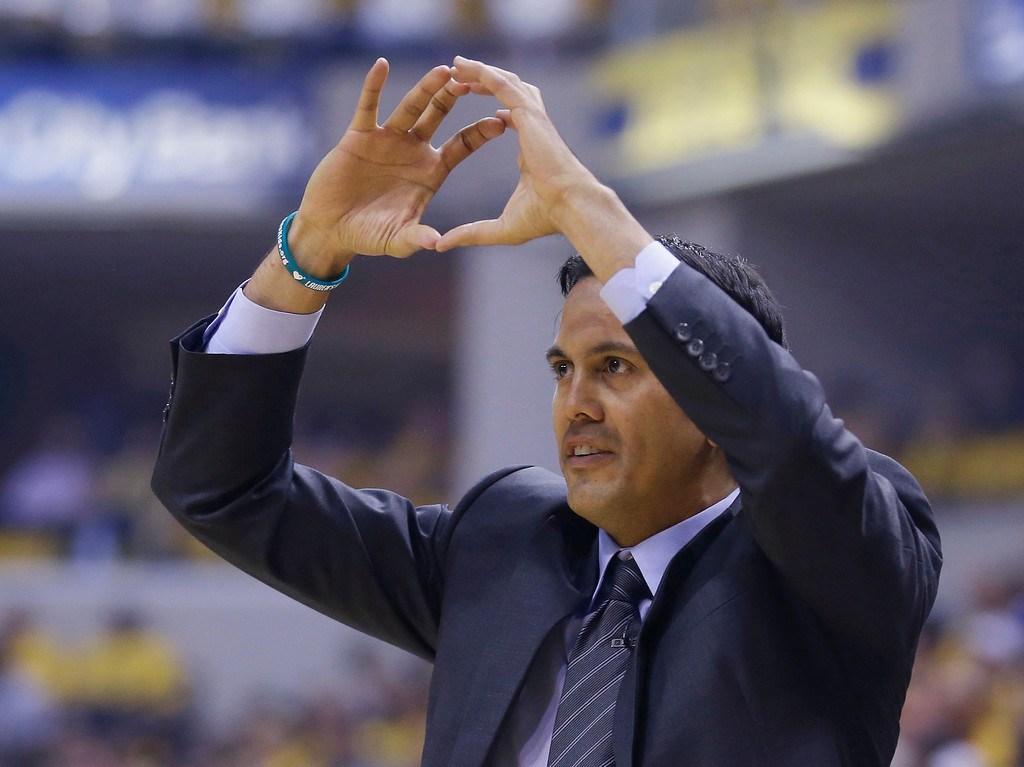. Miami Heat coach Erik Spoelstra calls a play during the first half of Game 2 of the NBA basketball Eastern Conference finals against the Indiana Pacers in Indianapolis, Tuesday, May 20, 2014. (AP Photo/Michael Conroy)