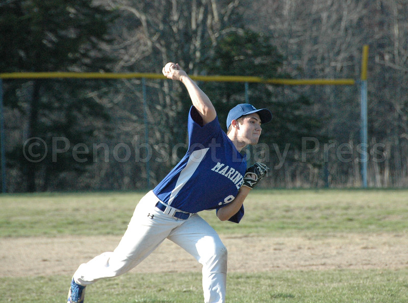 Silas Bates fires a pitch in against Bangor Christian. Photo by Jack Scott