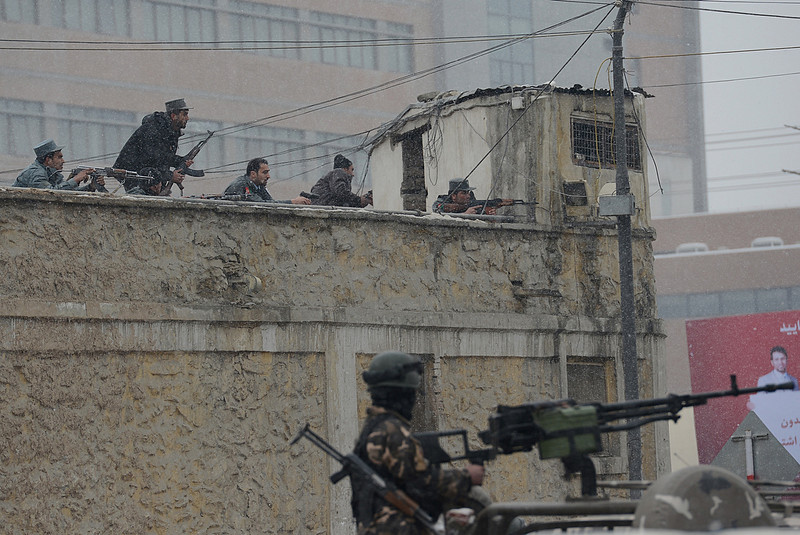 . Afghan security forces exchange fire with militants at the site of a suicide attack near the Afghan intelligence agency headquarters in Kabul on January 16, 2013. A squad of suicide bombers attacked the national intelligence agency headquarters in heavily-fortified central Kabul on January 16, killing at least two guards and wounding dozens of civilians, officials said.  SHAH MARAI/AFP/Getty Images