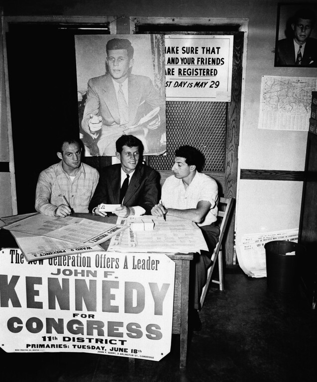 """. This 1946 file photo shows John F. Kennedy at one of his campaign headquarters. The Kennedy image, the \""""mystique\"""" that attracts tourists and historians alike, did not begin with his presidency and is in no danger of ending 50 years after his death. Its journey has been uneven, but resilient, a young and still-evolving politician whose name was sanctified by his assassination, upended by discoveries of womanizing, hidden health problems and political intrigue, and forgiven in numerous polls that place JFK among the most beloved of former presidents. (AP Photo, File)"""