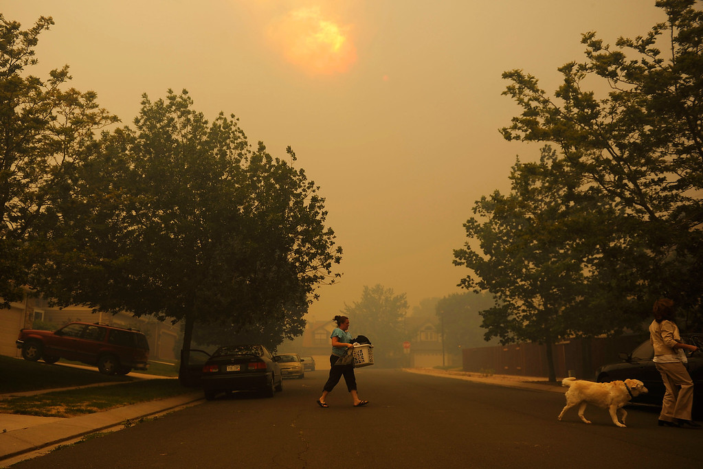 . Residents flee their homes when the Mountain Shadows subdivision is evacuated as the Waldo Canyon Fire roared out of the foothills and into Colorado Springs on Tuesday June 26, 2012. RJ Sangosti, The Denver Post