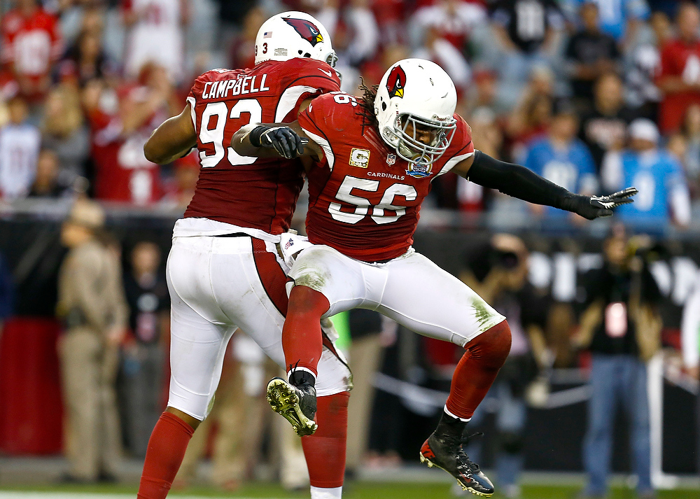 . Arizona Cardinals\' Reggie Walker (56) and Calais Campbell (93) celebrate a sack against the Detroit Lions Matthew Stafford during the second half in an NFL football game on Sunday Dec. 16, 2012, in Glendale, Ariz.  The Cardinals defeated the Lions 38-10. (AP Photo/Ross D. Franklin)