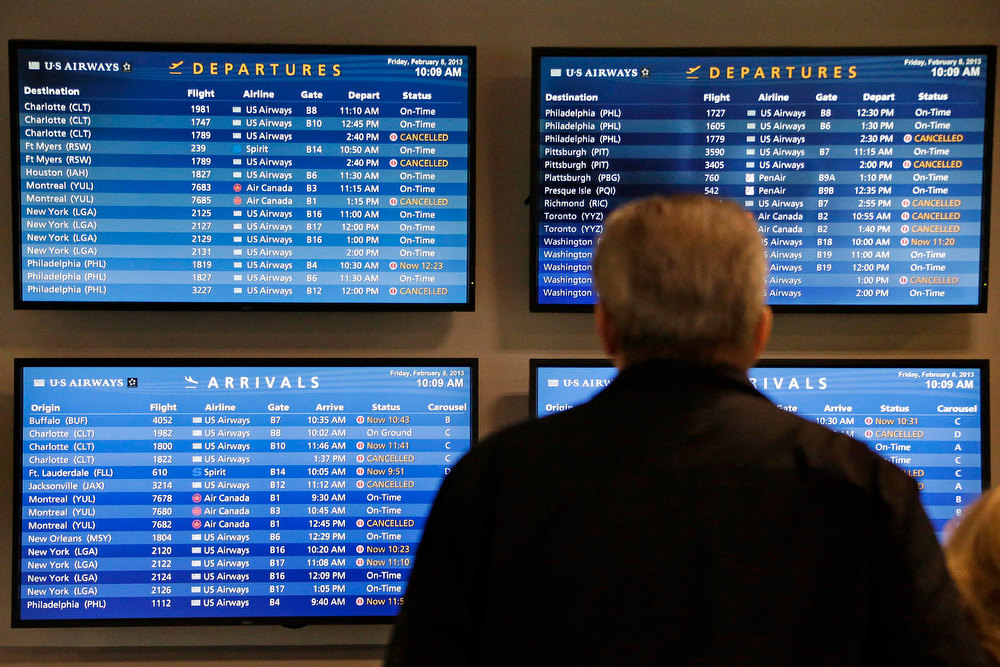 . TV monitors at Logan International Airport in Boston show cancelled flights Friday morning, Feb. 8, 2013.  Boston and much of eastern Massachusetts was under a blizzard warning until 1 p.m. Saturday. Logan International Airport said it would try to stay open during the storm but airlines had already canceled many flights through Saturday. (AP Photo/Gene J. Puskar)
