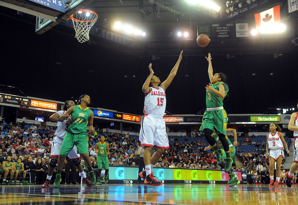 . Poly\'s Briana Johnson shoots over Salesian\'s Zoe Correal at Sleep Train Arena in Sacramento, CA on Saturday, March 29, 2014. Long Beach Poly vs Salesian in the CIF Open Div girls basketball state final. 2nd half. Poly won 70-52. (Photo by Scott Varley, Daily Breeze)