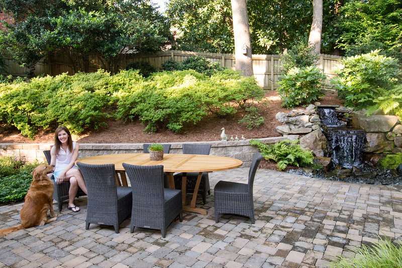 Cathy McLain and her husband have rennovated their backyard into a peacful space with outdoor dinning and a water feature.  The changes not only added value to their home but also address drainage issues and a steep incline that was once covered with railroad ties.  (Jenni Girtman / Atlanta Event Photography)