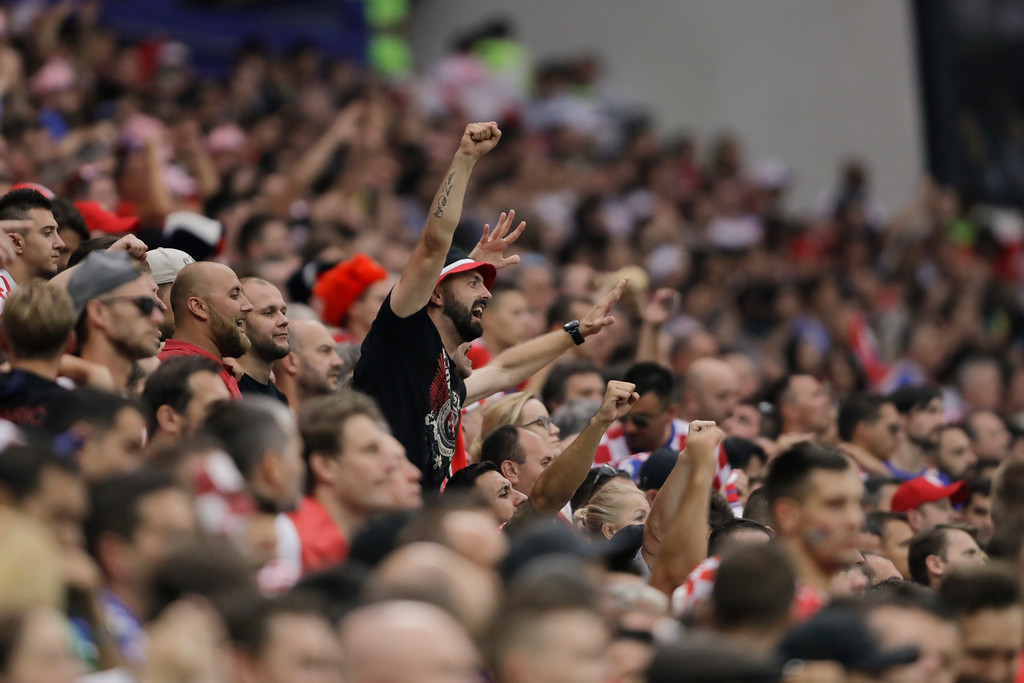 . A fan cheers during the final match between France and Croatia at the 2018 soccer World Cup in the Luzhniki Stadium in Moscow, Russia, Sunday, July 15, 2018. (AP Photo/Natacha Pisarenko)