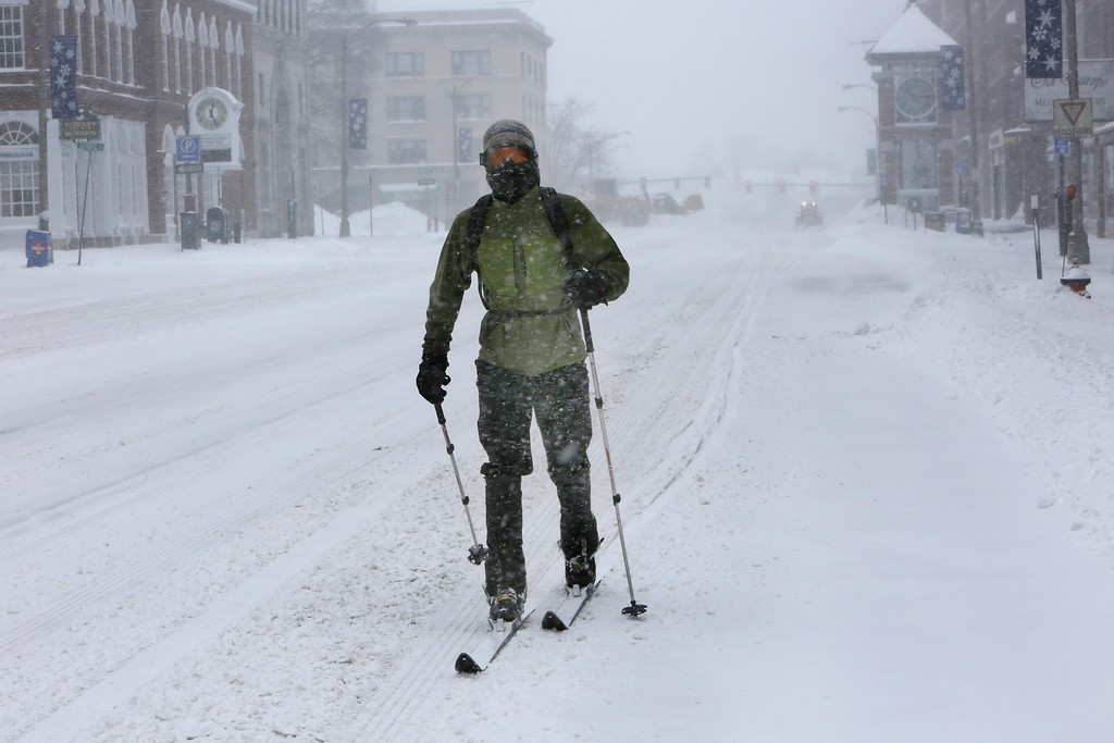 . Mike Wilmot skis down an empty Main Street during the snowstorm Tuesday, Jan. 27, 2015, in Concord, N.H.  The National Weather Service was still calling for storm totals of 18-24 inches in southeastern and coastal New Hampshire, with the amount falling as you head north and west. Concord was expected to get about a foot while north of the White Mountains, Colebrook was looking at 2 to 6 inches. (AP Photo/Jim Cole)