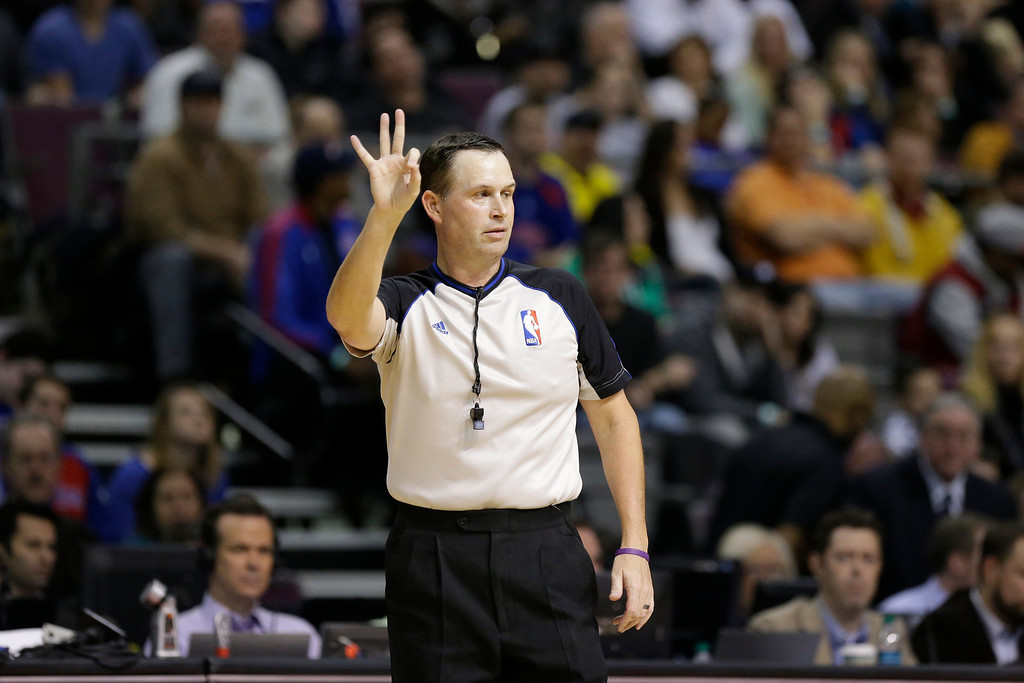 . Referee Mark Wunderlich (18) signals during the second quarter of an NBA basketball game between the Detroit Pistons and the Los Angeles Lakers at the Palace in Auburn Hills, Mich., Friday, Nov. 29, 2013. (AP Photo/Carlos Osorio)