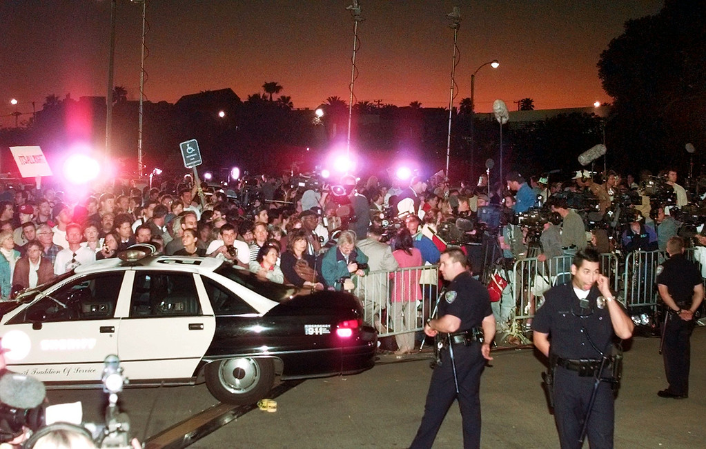 . FILE - In this Feb. 4, 1997, file photo,  A large crowd gathers outside Los Angeles County Superior Court in Santa Monica, Calif., to hear the verdict in the wrongful-death civil trial against O.J. Simpson. Simpson was found liable in the deaths of Nicole Brown Simpson and Ron Goldman. The return of O.J. Simpson to a Las Vegas courtroom next Monday, May, 13,  will remind Americans of a tragedy that became a national obsession and in the process changed the country\'s attitude toward the justice system, the media and celebrity. (AP Photo/Mark J. Terrill, File)