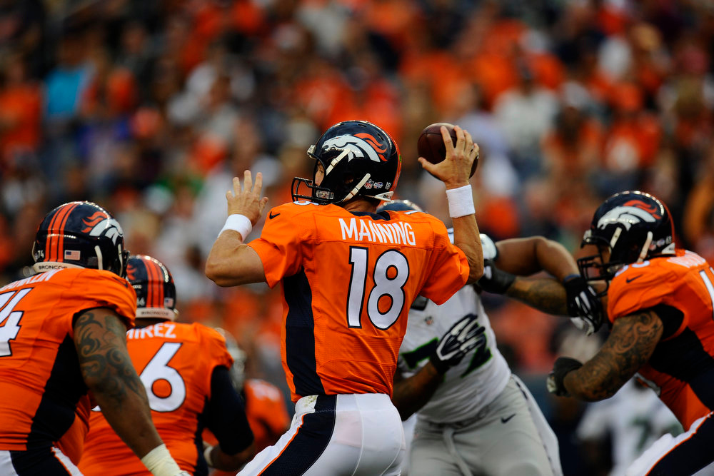 . Peyton Manning (18) of the Denver Broncos passes against the Seattle Seahawks during first quarter action of a preseason game at Sports Authority Field at Mile High on Thursday, August 07, 2014 in Denver, Colorado.  (Photo by Kent Nishimura/The Denver Post)