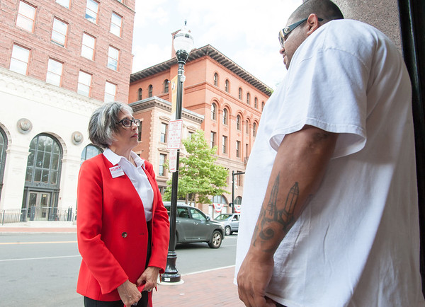 08/02/18 Wesley Bunnell | Staff Ruby Corby O'Neill speaks with co-owner of The Hive Steve Ayala on Thursday afternoon outside of his store as she toured downtown New Britain. O'Neill is running for for Congress for Connecticut's 5th district.