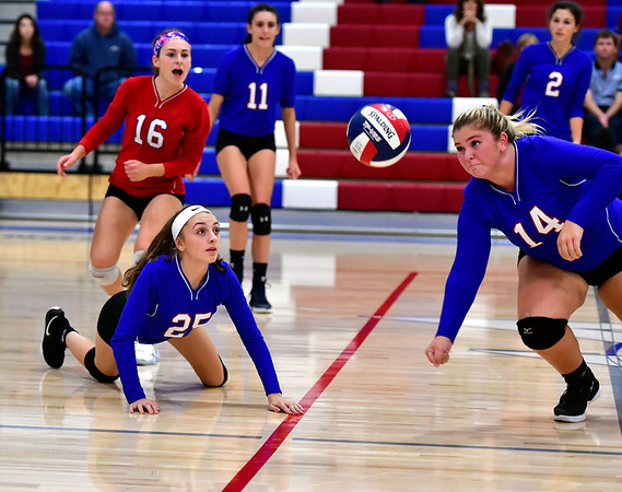 10/11/2019 Mike Orazzi | StaffrSt. Paul's Emily Esposito (25) and Megan Fortier (14) during Thursday nights girls volleyball with Torrington in Bristol.