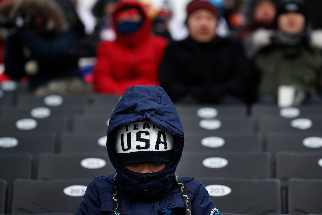 . Dylan Chae, 6, of the United States, braves the cold weather while waiting for the start of the women\'s slopestyle qualifications at Phoenix Snow Park at the 2018 Winter Olympics in Pyeongchang, South Korea, Sunday, Feb. 11, 2018. The event was postponed due to weather conditions. (AP Photo/Jae C. Hong)