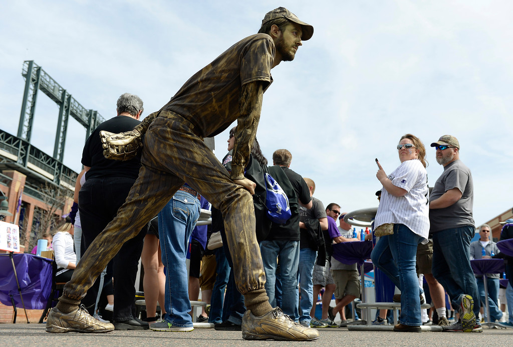 . LoDo was hopping early as Colorado Rockies fans came downtown for Opening Day  on Friday, April 8, 2016.    Shane Borrillo was dressed in bronze like a sculpture to entertain Rockies fans at a block party at 20th Street and Blake  in front of Coors Field.  (Photo by Cyrus McCrimmon/ The Denver Post)